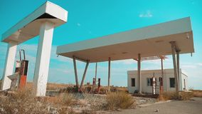 Route 66. crisis road 66 fueling slow motion video. Old dirty deserted gas station. U.S. closed supermarket store shop. Abandoned gas station oil end of fuel stock footage