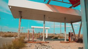 Route 66. crisis road 66 fueling slow motion video. Old dirty deserted gas station. U.S. lifestyle closed supermarket. Store shop Abandoned gas station oil end stock footage