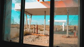 Route 66. Crisis road 66 fuelling broken window slow motion video. Old dirty deserted gas station lifestyle. U.S. closed. Supermarket store shop Abandoned gas stock video footage