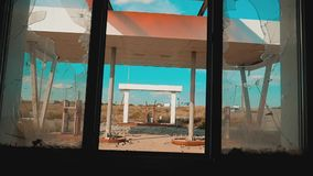 Route 66. Crisis road 66 fuelling broken window slow motion video. Old dirty deserted gas station. U.S. closed. Supermarket store shop Abandoned gas station oil stock video footage