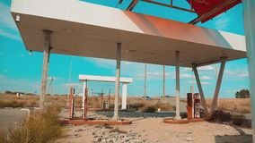 Route 66. Crisis road 66 fuelling slow motion video. Old dirty deserted gas lifestyle station. U.S. closed supermarket. Store shop Abandoned gas station oil end stock footage