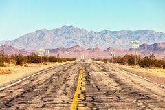 Route 66 crossing the Mojave Desert near Amboy, California, United States . The road is under repairs royalty free stock photo
