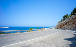 Route D400 and Aegean Sea in Summer. Road D400 is the most famous self-driving route for tourists. Taken at Kas, Turkey stock photography
