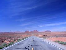 Route dans le désert Photographie stock libre de droits