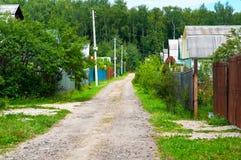 Route dans le village Images libres de droits