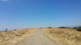 Route dans un domaine Images stock