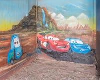 Route 66: De bliksem McQueen en Sally Carrera Mural, Blauw slikt Motel, Tucumcari, NM Stock Afbeelding