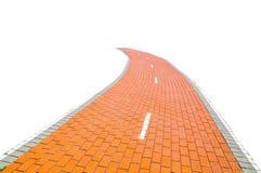 Route de brique rouge d'isolement sur le fond blanc image libre de droits