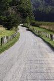 Route de campagne vide de gravier Images stock