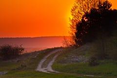 Route de coucher du soleil image stock