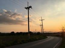 Route de gens du pays de coucher du soleil Photos libres de droits