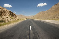 Route on the desert. Straight route on the desert. Mountain view - Armenia Royalty Free Stock Images