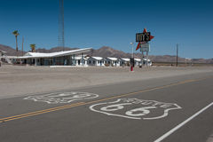 Route 66. At the edge of the mojave desert in Arizona, sits the iconic Roy's Motel - part of the famous American Mother Road Route 66 Stock Photos