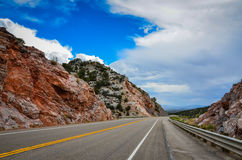 Route 50 - Ely, Nevada. Route 50, known as the Loneliest Road in America, as it departs Ely, Nevada heading east through rocks and desert royalty free stock photo