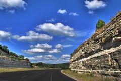 route et nuages Photo stock
