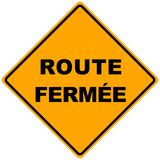Route fermee sign. Orange road sign route fermee -illustration Road closed Royalty Free Stock Photography