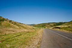 Route going through hills Royalty Free Stock Photography
