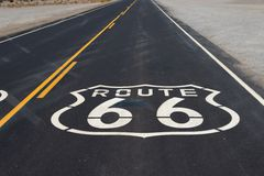Route 66 highway shield painted on road in California Royalty Free Stock Images
