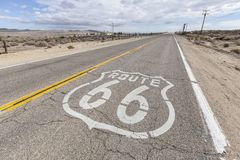 Route 66. Historic US Route 66 through California's arid mojave desert Royalty Free Stock Photo
