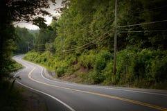 Route incurvée dans les montagnes Images stock