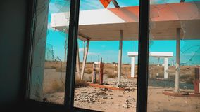 Route 66. lifestyle crisis road 66 fueling broken window slow motion video. Old dirty deserted gas station. U.S. closed. Supermarket store shop Abandoned gas stock footage