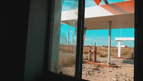 Route 66 lifestyle. crisis road 66 fueling broken window slow motion video. Old dirty deserted gas station. U.S. closed. Supermarket store shop Abandoned gas stock footage