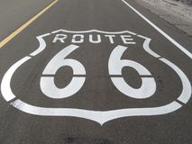 Route 66 Logo Printed on the Mother Road in California Royalty Free Stock Images