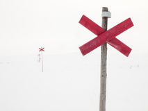 Route markers through arctic winter landscape Royalty Free Stock Image