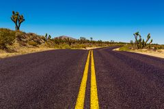 Route 66 through Mojave Desert. Famous Route 66 going through Mojave Desert in California Royalty Free Stock Photo