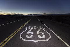 Route 66 Mojave Desert Night. Route 66 pavement sign at night in the Southern California Mojave desert Royalty Free Stock Photography