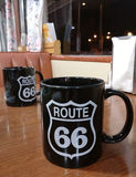 Route 66 mug. Black cups with logo of historic route 66 on the table at traditional american retro diner. Williams, Arizona, USA Stock Photos