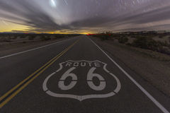 Route 66 Night Highway. Historic Route 66 highway pavement sign late at night in the California Mojave desert Royalty Free Stock Photo