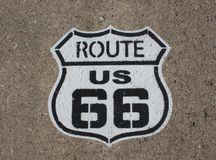 Route 66 painted signage. Historical route 66 painted signage on pavement royalty free stock image