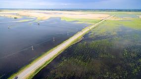 Route par les champs inondés Photo libre de droits