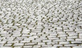 Route pavée en cailloutis comme fond Photos stock