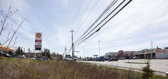 Route 7 through Porters Lake. May 12, 2018- Porters Lake, Nova Scotia: The main drag, route 7, goes through the central area of Porters Lake with stores and gas Royalty Free Stock Photos