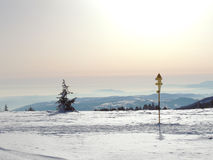 Route Post on Snowy Mountain Plateau Royalty Free Stock Images