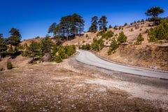Route poussiéreuse dans les montagnes Photos libres de droits