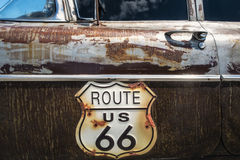 Route 66 road sign. On the side of a old car Stock Photography
