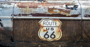 Route 66 road sign. On the side of a old car Stock Images
