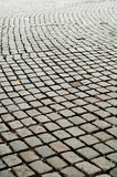 Route rugueuse de trottoir de pavé rond Photographie stock