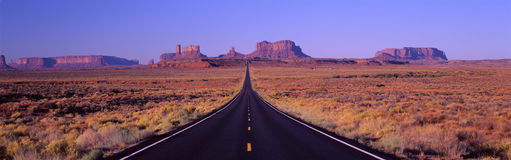 This is Route 163 that runs through the Navajo Indian Reservation. The road runs up the middle and gets smaller into infinity. The Stock Images