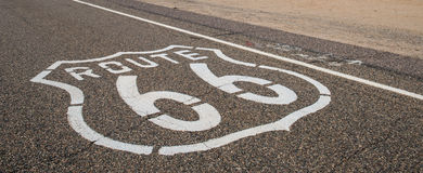 Route 66 sign. Sign in asphalt of Historic Route 66 stock images