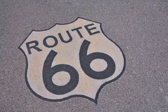 Route 66 sign in asphalt, USA. Stock Photo