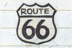 The Route 66 sign. Historic Route 66 road sign on a white wall in Barstow, California, famous crossroads between Los Angeles and Las Vegas. Mother Road or Sixty royalty free stock photos
