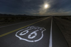 Route 66 Sign with Mojave Desert Full Moon. Route 66 sign with full moon in the California Mojave desert Stock Photo