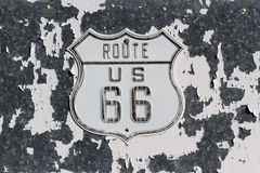 Route 66 Sign. Old Route 66 Sign on peeling painted wall Stock Photos