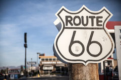 Route 66 sign on a US highway. The famous Route 66 is one of the oldest highways through the US and nearly 2,500 miles long Stock Image