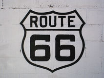 Route 66 sign on a white wall in Williams (Arizona). U.S. Route 66 was one of the original highways within the U.S. Highway System. It's one of the most Stock Photos