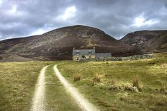 A route to Mount Keen. Cairngorm Mountains, Aberdeenshire, Scotland. Route to Mount Keen and Glenmark Cottage. Glen Mark, Aberdeenshire, Cairngorm National Park royalty free stock photography